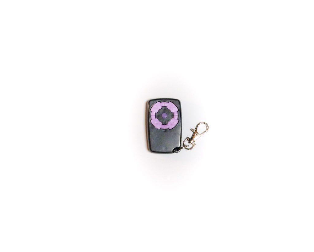 Télécommande électronique portail noir rose